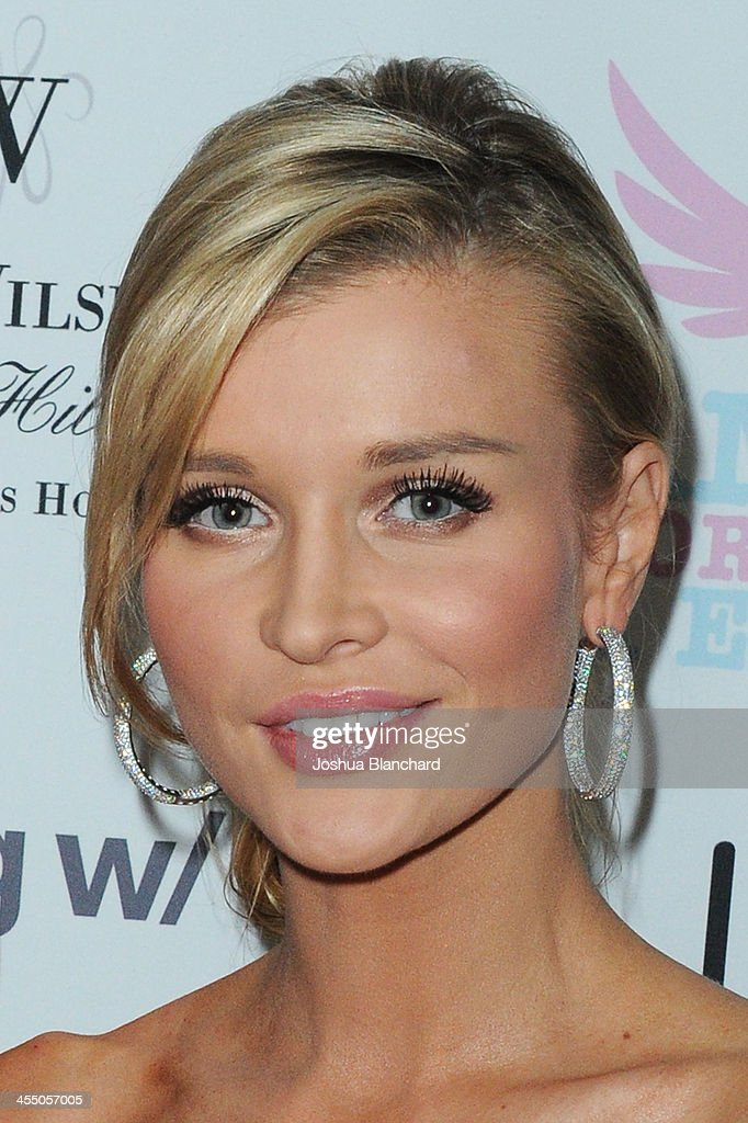 TV Personality <a gi-track='captionPersonalityLinkClicked' href=/galleries/search?phrase=Joanna+Krupa&family=editorial&specificpeople=224038 ng-click='$event.stopPropagation()'>Joanna Krupa</a> arrives at Angels For Animal Rescue benefit hosted by <a gi-track='captionPersonalityLinkClicked' href=/galleries/search?phrase=Joanna+Krupa&family=editorial&specificpeople=224038 ng-click='$event.stopPropagation()'>Joanna Krupa</a> at the Beverly Wilshire Four Seasons Hotel on December 10, 2013 in Beverly Hills, California.