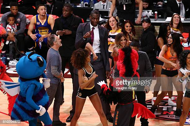 TV personality Jon Stewart Victor Oladipo of the Orlando Magic former NBA player Dikembe Mutombo and actor Anthony Anderson dance with cheerleaders...