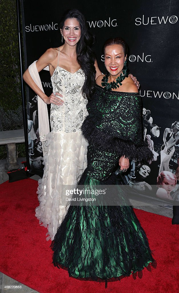 TV personality Joyce Giraud de Ohoven (L) and designer Sue Wong attend Sue Wong's holiday party at her home on December 20, 2013 in Los Angeles, California.