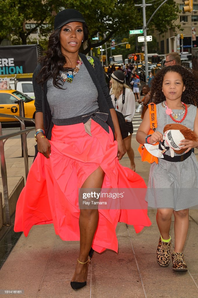 TV personality June Ambrose (L) and daughter Summer Chamblin enter the Mercedes-Benz Fashion Week at Lincoln Center on September 6, 2012 in New York City.