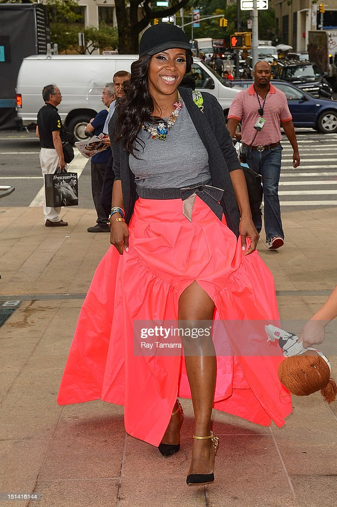 TV personality June Ambrose enters the Mercedes-Benz Fashion Week at Lincoln Center on September 6, 2012 in New York City.
