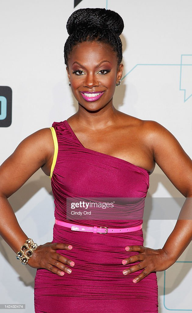 TV personality <a gi-track='captionPersonalityLinkClicked' href=/galleries/search?phrase=Kandi+Burruss&family=editorial&specificpeople=4401257 ng-click='$event.stopPropagation()'>Kandi Burruss</a> attends the Bravo Upfront 2012 at Center 548 on April 4, 2012 in New York City.