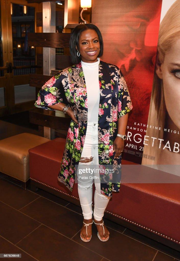TV personality Kandi Burruss attends the Kenya Moore 'Unforgettable' Atlanta screening at Cinebistro Town Brookhaven on April 12, 2017 in Atlanta, Georgia.