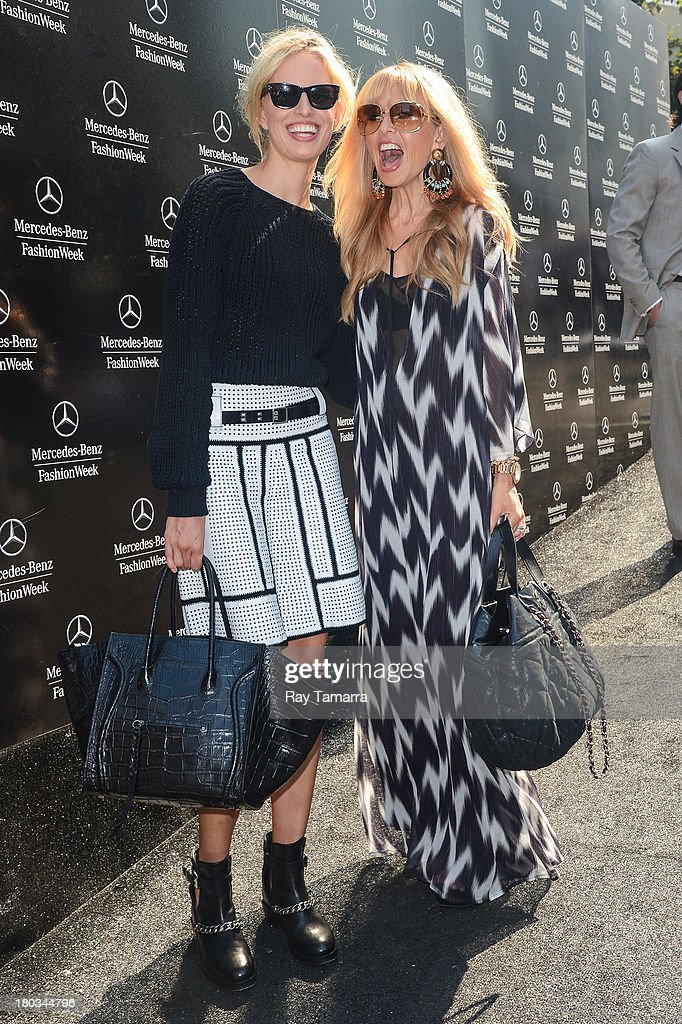 TV personality Karolina Kurkova (L) and fashion designer Rachel Zoe pose for photos at the Mercedes-Benz Fashion Week at Lincoln Center for the Performing Arts on September 11, 2013 in New York City.