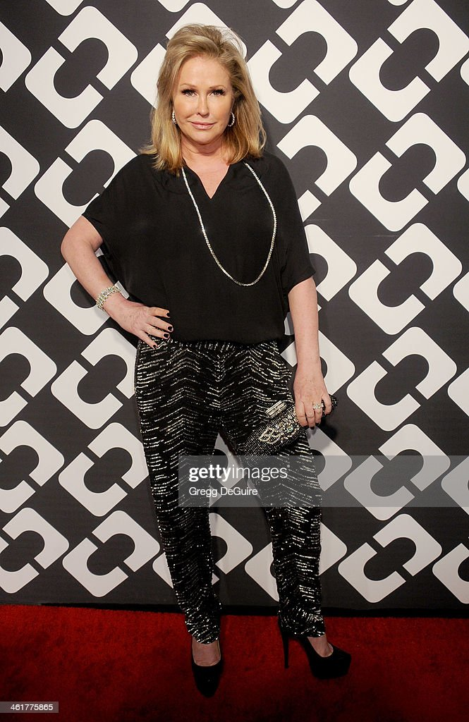 TV personality Kathy Hilton arrives at Diane Von Furstenberg's 'Journey Of A Dress' premiere opening party at Wilshire May Company Building on January 10, 2014 in Los Angeles, California.