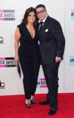 TV personality Kathy Wakile and husband Rich Wakile attend the 2013 American Music Awards at Nokia Theatre LA Live on November 24 2013 in Los Angeles...