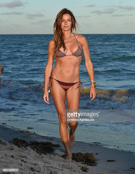 TV personality Kelly Killoren Bensimon poses wearing a Charlie by MZ bikini for a private photo shoot on December 6 2014 along Miami Beach Florida