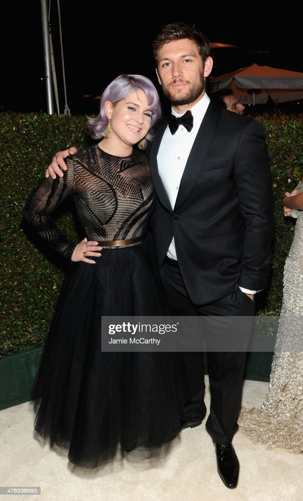 TV personality Kelly Osbourne (L) and actor Alex Pettyfer attend the 22nd Annual Elton John AIDS Foundation Academy Awards Viewing Party at The City of West Hollywood Park on March 2, 2014 in West Hollywood, California.