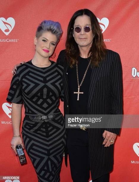 TV personality Kelly Osbourne and musician Ozzy Osbourne attend the 10th annual MusiCares MAP Fund Benefit Concert at Club Nokia on May 12 2014 in...