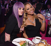 TV personality Kelly Osbourne and singer Mariah Carey attend the 24th Annual Elton John AIDS Foundation's Oscar Viewing Party at The City of West...
