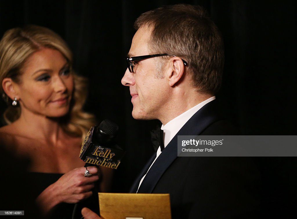 TV personality Kelly Ripa (L) and Actor Christoph Waltz, winner of the award for Performance by an Actor in a Supporting Role, backstage during the Oscars held at the Dolby Theatre on February 24, 2013 in Hollywood, California.