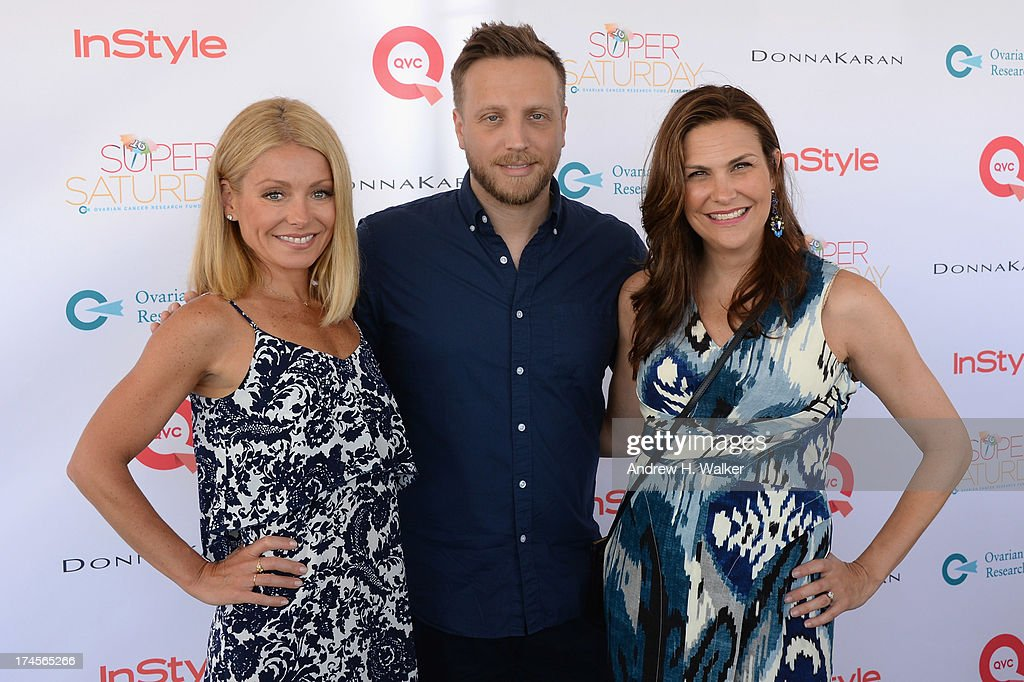 TV Personality Kelly Ripa, editor in chief at InStyle Ariel Foxman and publisher at InStyle Karin Tracy attend the Ovarian Cancer Research Fund's 16th Annual Super Saturday hosted by Kelly Ripa and Donna Karan at Nova's Ark Project on July 27, 2013 in Water Mill, NY.