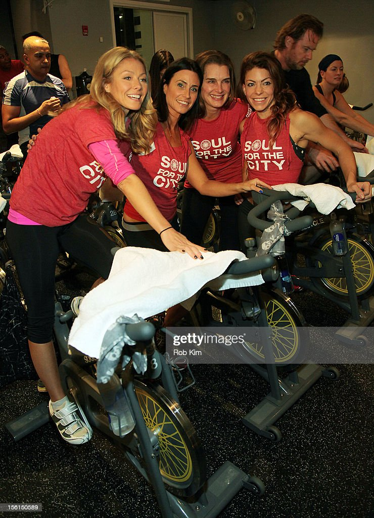 TV personality Kelly Ripa, instructor Laurie Cole, actress Brooke Shields and instructor Kym Perfetto attend SoulCycle's Soul Relief Rides at SoulCycle Tribeca on November 11, 2012 in New York City.