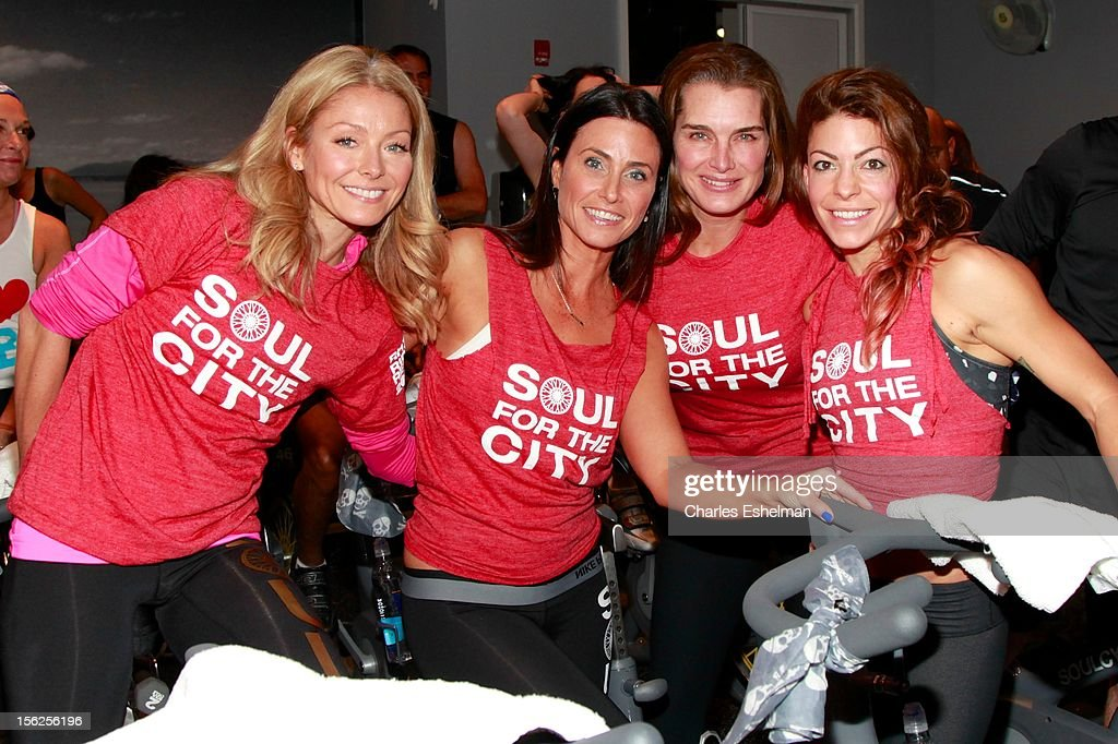 TV personality Kelly Ripa, instructor Laurie Cole, actress Brooke Shields and instructor Kym Perfetto spin spin in SoulCycle's Soul Relief Rides at SoulCycle Tribeca on November 11, 2012 in New York City.