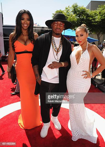 TV personality Kenya Moore recording artist NeYo and singer Adrienne Bailon attend the BET AWARDS '14 at Nokia Theatre LA LIVE on June 29 2014 in Los...