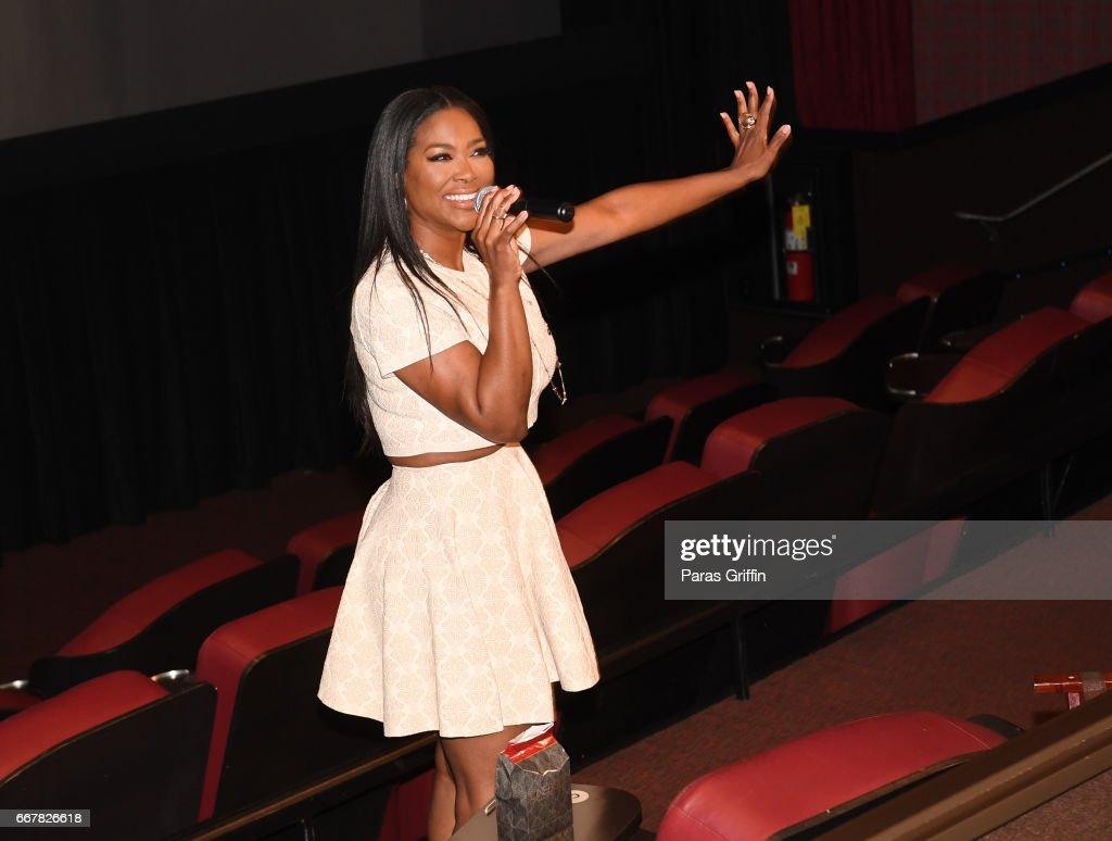 TV personality Kenya Moore speaks to the crowd at the Kenya Moore 'Unforgettable' Atlanta screening at Cinebistro Town Brookhaven on April 12, 2017 in Atlanta, Georgia.