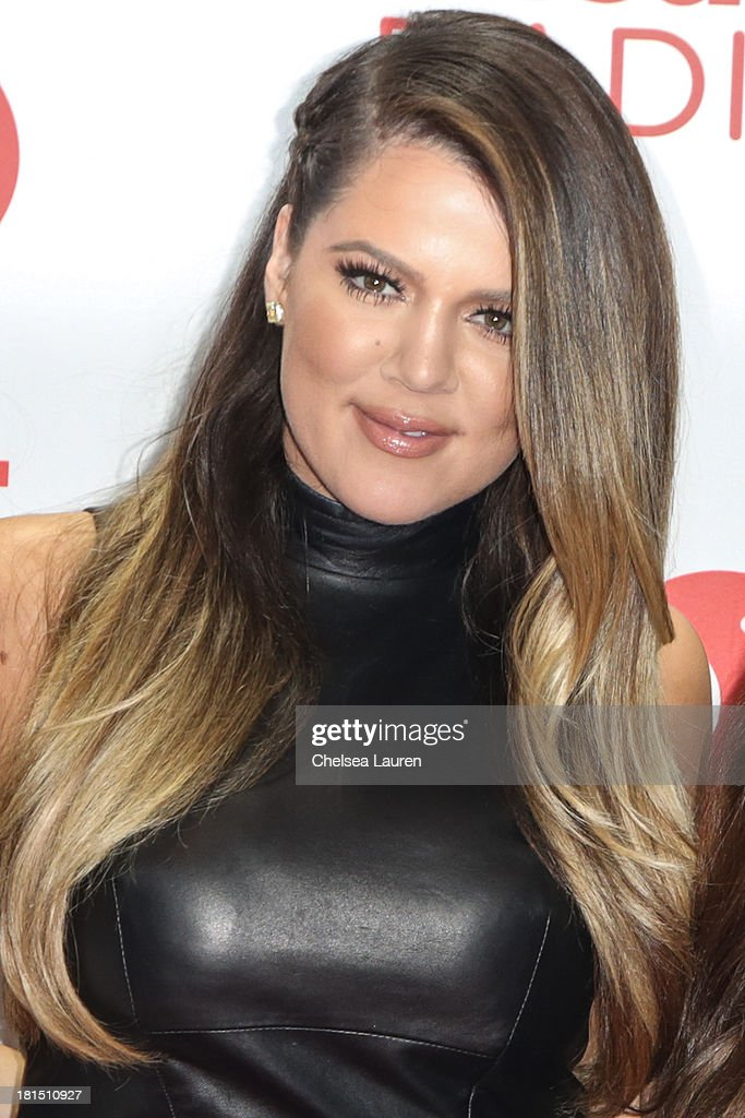 TV personality Khloe Kardashian poses in the iHeartRadio music festival photo room on September 21 2013 in Las Vegas Nevada