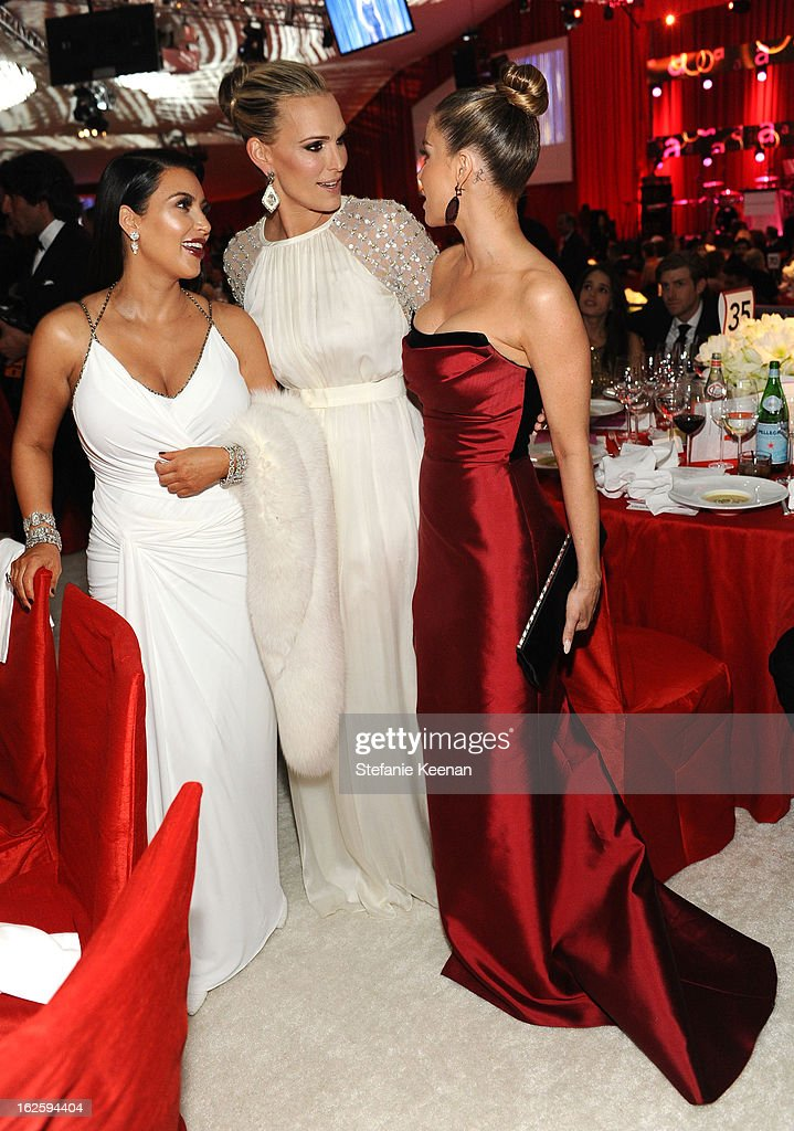 TV personality Kim Kardashian, actress Molly Sims and Carmen Electra attend Chopard at 21st Annual Elton John AIDS Foundation Academy Awards Viewing Party at West Hollywood Park on February 24, 2013 in West Hollywood, California.