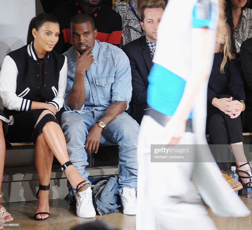 TV Personality <a gi-track='captionPersonalityLinkClicked' href=/galleries/search?phrase=Kim+Kardashian&family=editorial&specificpeople=753387 ng-click='$event.stopPropagation()'>Kim Kardashian</a> and Rapper <a gi-track='captionPersonalityLinkClicked' href=/galleries/search?phrase=Kanye+West+-+Musician&family=editorial&specificpeople=201803 ng-click='$event.stopPropagation()'>Kanye West</a> attend Louise Goldin Spring 2013 at Milk Studios on September 12, 2012 in New York City.