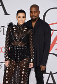 Personality Kim Kardashian and rapper Kanye West attend the 2015 CFDA Fashion Awards at Alice Tully Hall at Lincoln Center on June 1 2015 in New York...