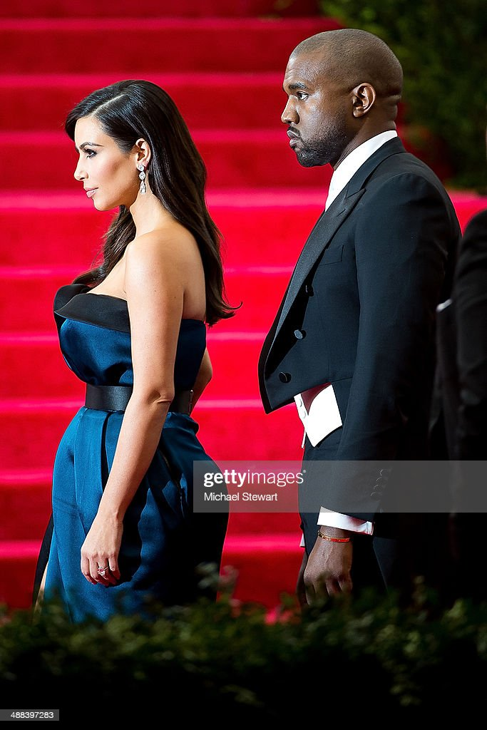 TV personality Kim Kardashian (L) and rapper Kanye West attend the 'Charles James: Beyond Fashion' Costume Institute Gala at the Metropolitan Museum of Art on May 5, 2014 in New York City.