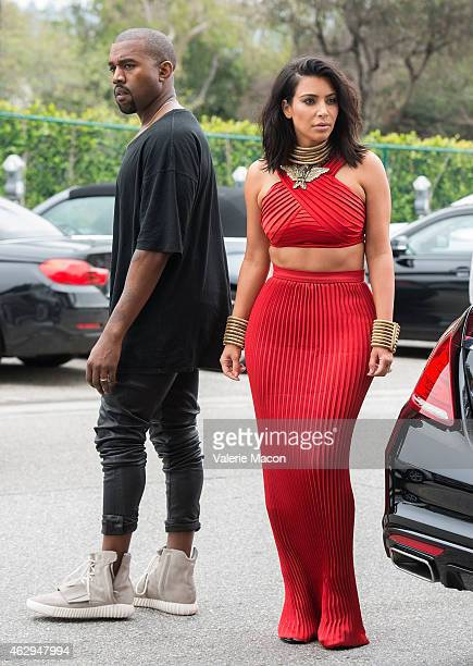 TV personality Kim Kardashian and recording artist Kanye West arrive at the Roc Nation PreGRAMMY Brunch on February 7 2015 in Beverly Hills California