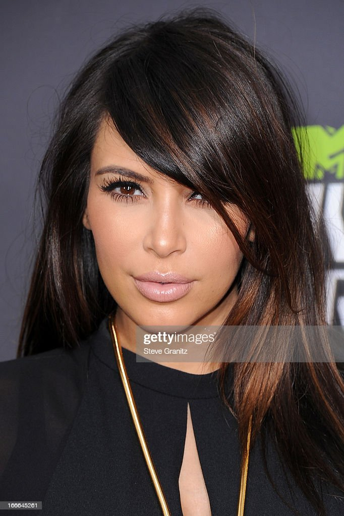 TV personality <a gi-track='captionPersonalityLinkClicked' href=/galleries/search?phrase=Kim+Kardashian&family=editorial&specificpeople=753387 ng-click='$event.stopPropagation()'>Kim Kardashian</a> arrives at the 2013 MTV Movie Awards at Sony Pictures Studios on April 14, 2013 in Culver City, California.