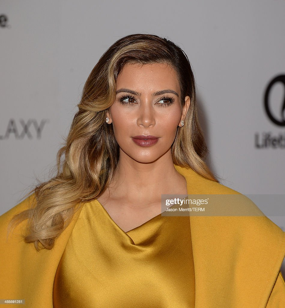 TV personality Kim Kardashian arrives at The Hollywood Reporter's 22nd Annual Women In Entertainment Breakfast at Beverly Hills Hotel on December 11, 2013 in Beverly Hills, California.