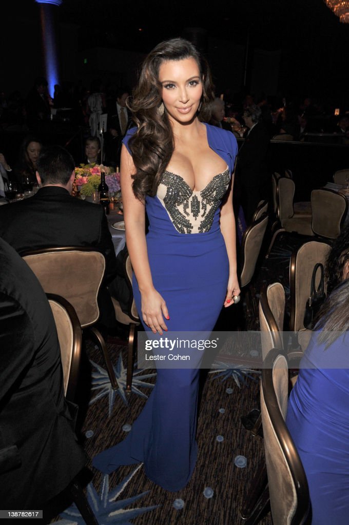 TV personality <a gi-track='captionPersonalityLinkClicked' href=/galleries/search?phrase=Kim+Kardashian&family=editorial&specificpeople=753387 ng-click='$event.stopPropagation()'>Kim Kardashian</a> attends Clive Davis and The Recording Academy's 2012 Pre-GRAMMY Gala and Salute to Industry Icons Honoring Richard Branson at The Beverly Hilton hotel on February 11, 2012 in Beverly Hills, California.