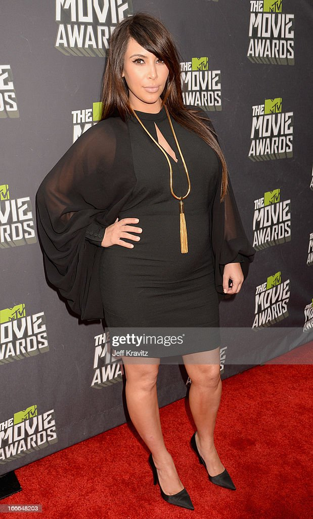 TV personality <a gi-track='captionPersonalityLinkClicked' href=/galleries/search?phrase=Kim+Kardashian&family=editorial&specificpeople=753387 ng-click='$event.stopPropagation()'>Kim Kardashian</a> attends the 2013 MTV Movie Awards at Sony Pictures Studios on April 14, 2013 in Culver City, California.