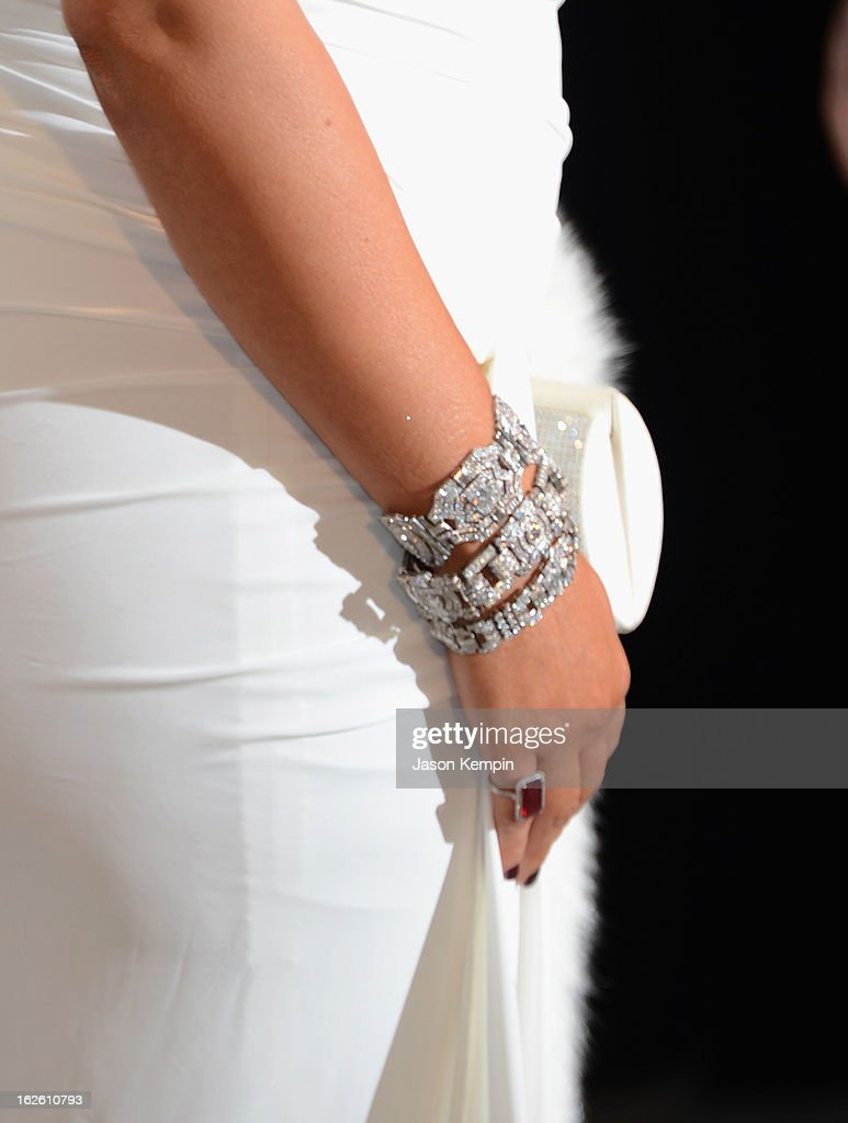 TV personality Kim Kardashian (fashion and jewelry detail) attends the 21st Annual Elton John AIDS Foundation Academy Awards Viewing Party at West Hollywood Park on February 24, 2013 in West Hollywood, California.