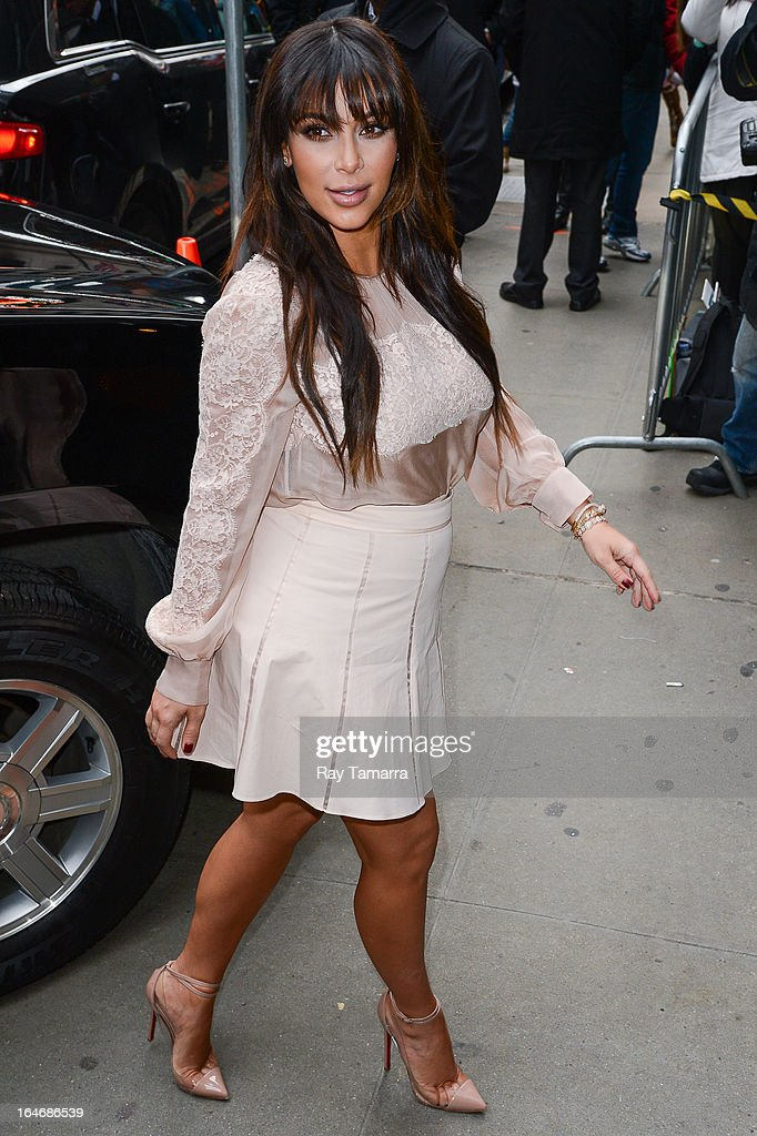 TV personality <a gi-track='captionPersonalityLinkClicked' href=/galleries/search?phrase=Kim+Kardashian&family=editorial&specificpeople=753387 ng-click='$event.stopPropagation()'>Kim Kardashian</a> enters the 'Good Morning America' taping at the ABC Times Square Studios on March 26, 2013 in New York City.