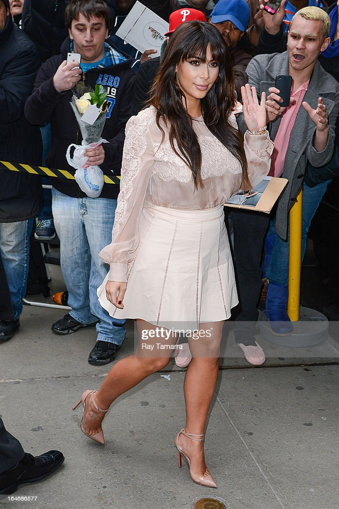 TV personality Kim Kardashian enters the 'Good Morning America' taping at the ABC Times Square Studios on March 26, 2013 in New York City.