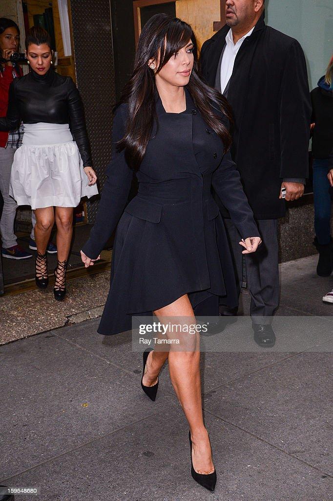TV personality <a gi-track='captionPersonalityLinkClicked' href=/galleries/search?phrase=Kim+Kardashian&family=editorial&specificpeople=753387 ng-click='$event.stopPropagation()'>Kim Kardashian</a> leaves the 'Today Show' taping at the NBC Rockefeller Center Studios on January 15, 2013 in New York City.