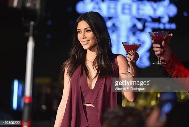 TV personality Kim Kardashian raises a toast for the Elizabeth Taylor AIDS Foundation and World AIDS Day at The Abbey on December 1 2014 in West...