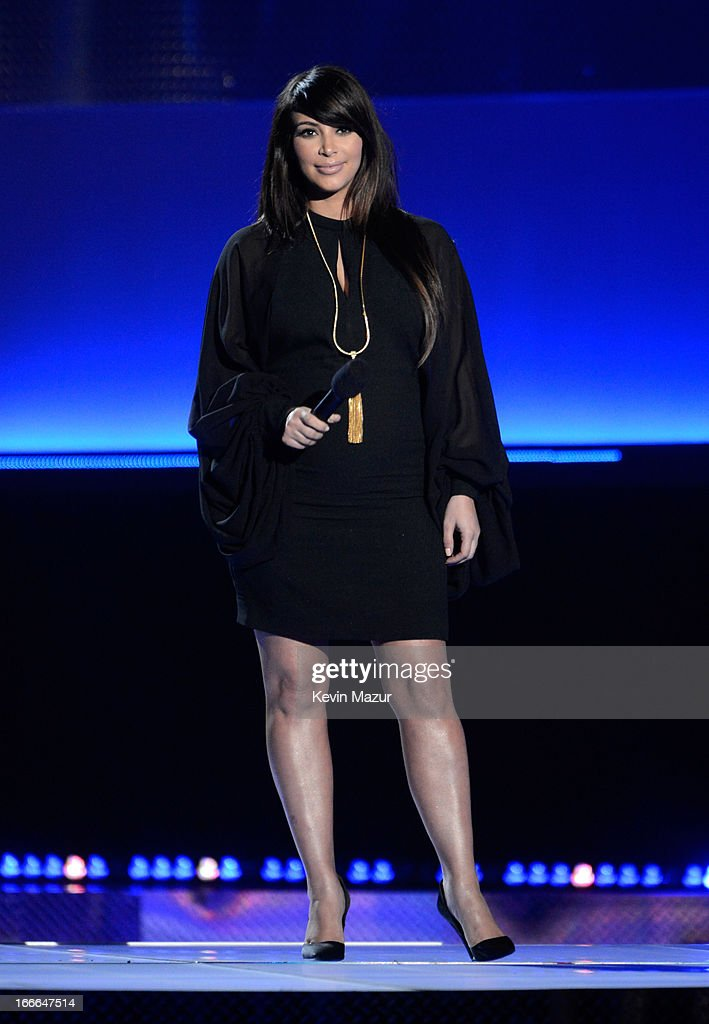 TV personality Kim Kardashian speaks onstage during the 2013 MTV Movie Awards at Sony Pictures Studios on April 14, 2013 in Culver City, California.