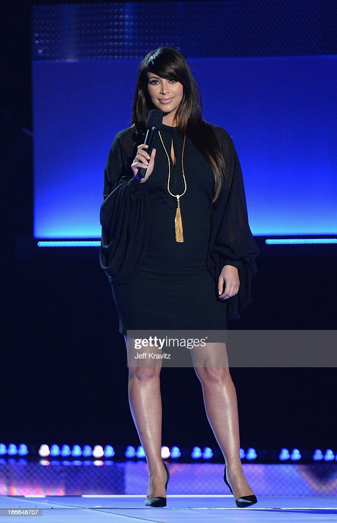 TV personality <a gi-track='captionPersonalityLinkClicked' href=/galleries/search?phrase=Kim+Kardashian&family=editorial&specificpeople=753387 ng-click='$event.stopPropagation()'>Kim Kardashian</a> speaks onstage during the 2013 MTV Movie Awards at Sony Pictures Studios on April 14, 2013 in Culver City, California.