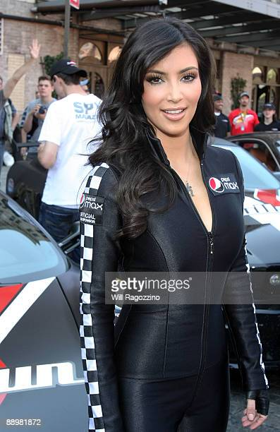 Personality Kim Kardashian waves the green flag at the Bullrun Rally 2009 Green Flag Rally Start Event at the Hotel Gansevoort on July 11 2009 in New...