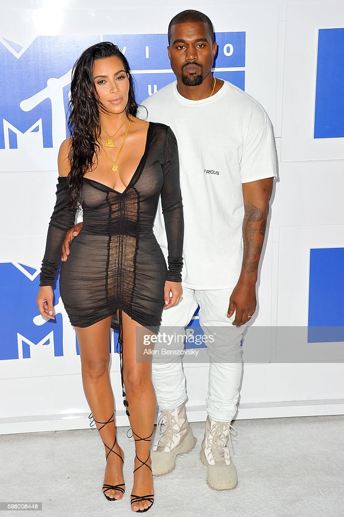 TV personality Kim Kardashian West and recording artist Kanye West arrive at the 2016 MTV Video Music Awards at Madison Square Garden on August 28, 2016 in New York City.