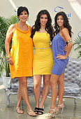 TV personality Kim Kardashian with her mother Kris and sister Kourtney attend a photocall promoting the television series 'Keeping Up With the...