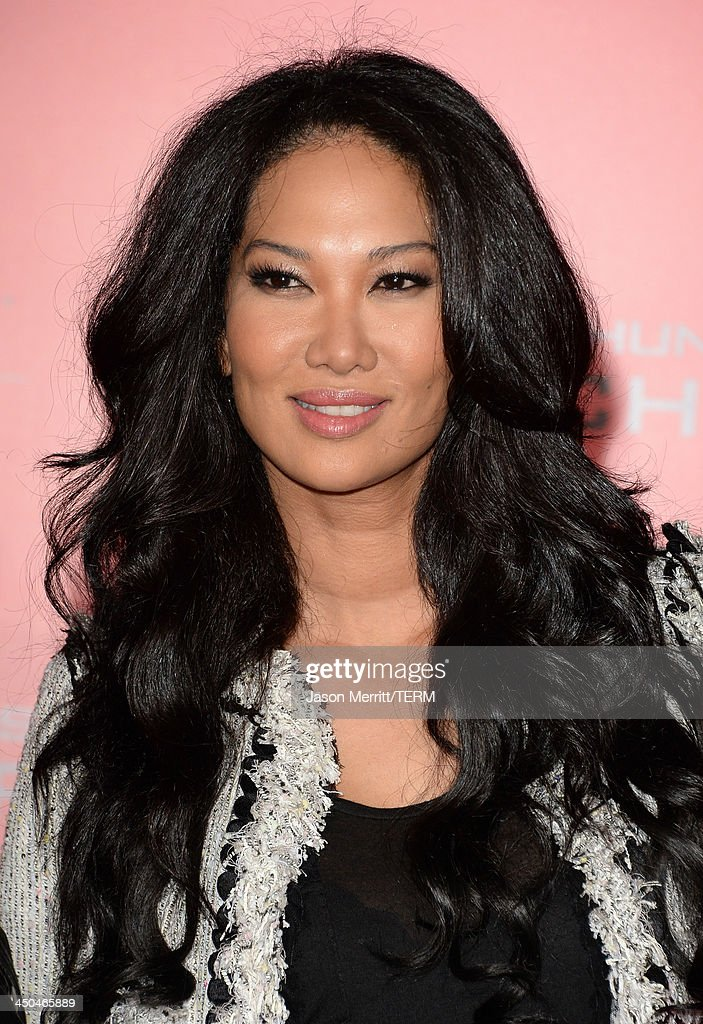 TV personality Kimora Lee Simmons arrives at the premiere of Lionsgate's 'The Hunger Games: Catching Fire' at Nokia Theatre L.A. Live on November 18, 2013 in Los Angeles, California.