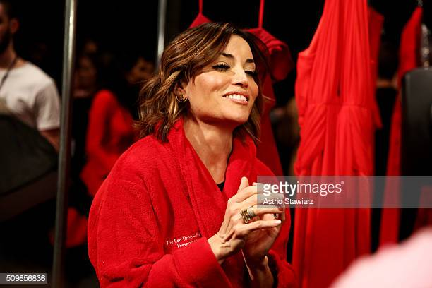 TV personality Kit Hoover prepares backstage at The American Heart Association's Go Red For Women Red Dress Collection 2016 Presented By Macy's at...