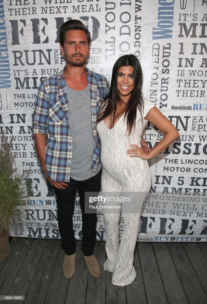 TV Personality <a gi-track='captionPersonalityLinkClicked' href=/galleries/search?phrase=Kourtney+Kardashian&family=editorial&specificpeople=3955024 ng-click='$event.stopPropagation()'>Kourtney Kardashian</a> and husband <a gi-track='captionPersonalityLinkClicked' href=/galleries/search?phrase=Scott+Disick&family=editorial&specificpeople=4420046 ng-click='$event.stopPropagation()'>Scott Disick</a> attend Women's Health Hosts Hamptons 'Party Under The Stars' for RUN10 FEED10 at Bridgehampton Tennis and Surf Club on August 9, 2014 in Bridgehampton, New York.