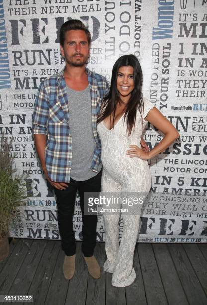 Personality Kourtney Kardashian and husband Scott Disick attend Women's Health Hosts Hamptons 'Party Under The Stars' for RUN10 FEED10 at...
