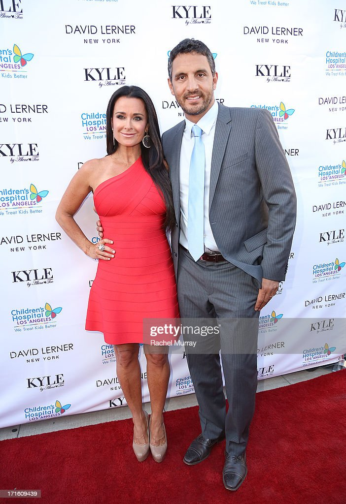 TV personality <a gi-track='captionPersonalityLinkClicked' href=/galleries/search?phrase=Kyle+Richards&family=editorial&specificpeople=2586434 ng-click='$event.stopPropagation()'>Kyle Richards</a> (L) and husband Mauricio Umansky attend <a gi-track='captionPersonalityLinkClicked' href=/galleries/search?phrase=Kyle+Richards&family=editorial&specificpeople=2586434 ng-click='$event.stopPropagation()'>Kyle Richards</a> hosts a Fashion Fundraiser for Children's Hospital Los Angeles at Kyle By Alene Too on June 26, 2013 in Beverly Hills, California.