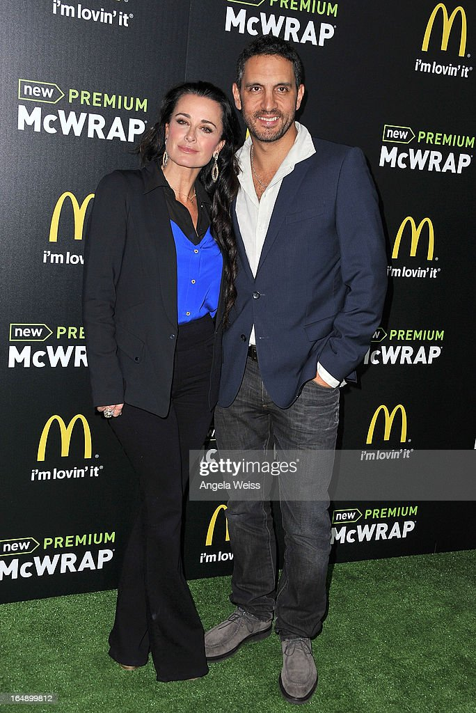 TV personality <a gi-track='captionPersonalityLinkClicked' href=/galleries/search?phrase=Kyle+Richards&family=editorial&specificpeople=2586434 ng-click='$event.stopPropagation()'>Kyle Richards</a> and Mauricio Umansky attend the launch party of McDonald's Premium McWrap at Paramount Studios on March 28, 2013 in Hollywood, California.