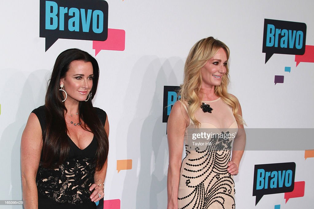 TV personality Kyle Richards and Taylor Armstrong of 'The Real Housewives of Beverly Hills' attend the 2013 Bravo Upfront at Pillars 37 Studios on April 3, 2013 in New York City.