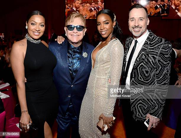 TV personality La La Anthony host Sir Elton John singer Kelly Rowland and host David Furnish attend the 24th Annual Elton John AIDS Foundation's...