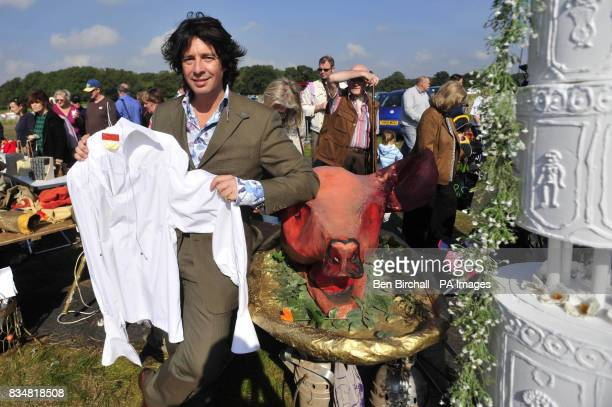 TV personality Lawrence LlewellynBowen with a shirt he is auctioning for charity at a car boot sale at Manor Farm Chedworth Gloucestershire