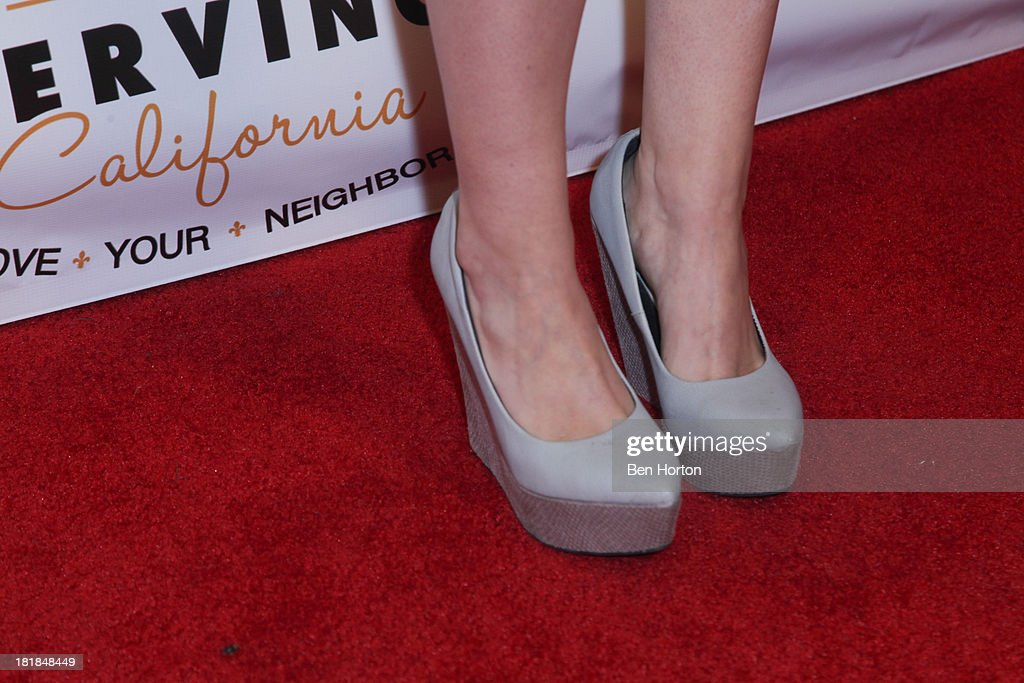 TV personality Lily Elise (shoe detail) attends the Guggenheim partners present: The Justice Ball at Boulevard3 on September 24, 2013 in Hollywood, California.